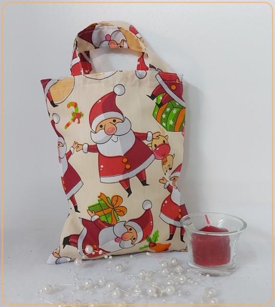 Kleiner Stoffbeutel mit Weihnachtsmänner,süßen Rentieren und Geschenke