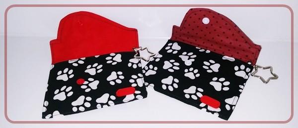 Multitäschchen Schwarz mit weißen Pfötchen und roten Unistoff