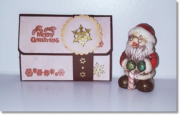 Kleine Gutscheinkarte in schokobraunen Cardstock und Merry Christmas Stempel und goldenen Sternensti